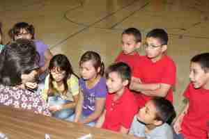 Native American youth listen to local nurse.