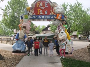 Some of our Native American girls standing at the zoo entrance.