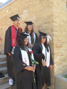 Four students from St. Joseph's Indian School pause for a graduation picture.