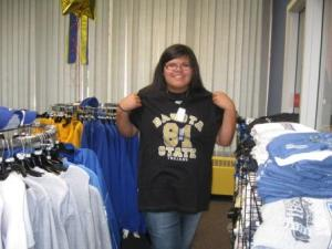 Native American student shopping in a college bookstore.
