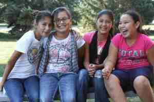 These Native American girls can't wait to see their new home!