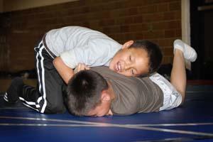 Native American students practice wrestling