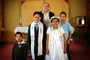 The Lakota (Sioux) children at St. Joseph's participate in the Rites of Initiation with the support of their families.