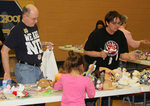 Fr. Steve helped the Lakota students at the prize table during St. Joseph's Sobriety Carnival.