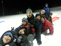 Jachin and the boys in the Ambrose Home take on the sledding hill.