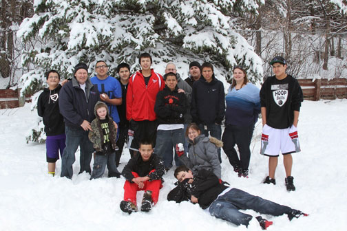 The Lakota children enjoyed mild temperatures while playing in the April snow!
