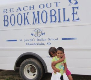 St. Joseph's Bookmobile travels to the reservation giving away free books each summer.