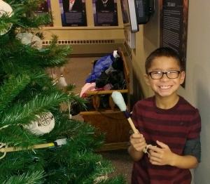 The Lakota children decorated a Christmas tree at the South Dakota Hall of Fame.