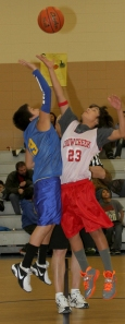 Opposing teams jump for the ball at St. Joseph's Indian School.