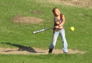 St. Joseph's students learn basic softball skills – hitting, catching and throwing.