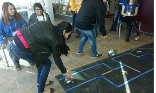 St. Joseph's eighth grade girls programmed a robot to navigate an obstacle course as part of the GEMS workshop.