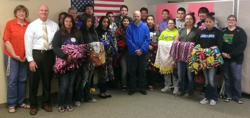 Eighth grade students received a gift from a former employee.