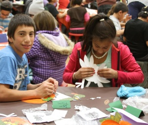 Cousins and siblings enjoyed making Thanksgiving decorations together for their families.