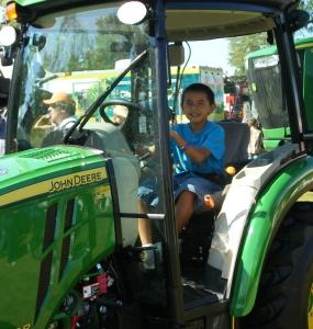 The Lakota boys loved the farm equipment!