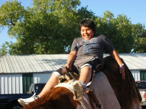 Only one of the boys tried riding the mechanical bull at the fair.