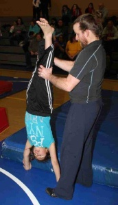 St. Joseph's gymnastics girls don't participate in competitions yet, but focus on learning the basics.