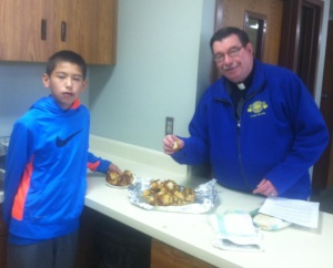 Fr. Anthony sampled the monkey bread the sixth graders were baking in class.