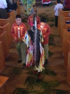 The Eagle Staff leads the procession into Mass at Our Lady of the Sioux Chapel.