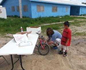 You need all kinds of skills on the bookmobile, including bike mechanics!