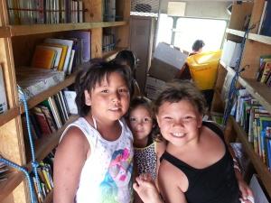 Lakota (Sioux) children choose books to take home.