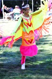 A Lakota (Sioux) girl dances fancy shawl at last year's powwow.