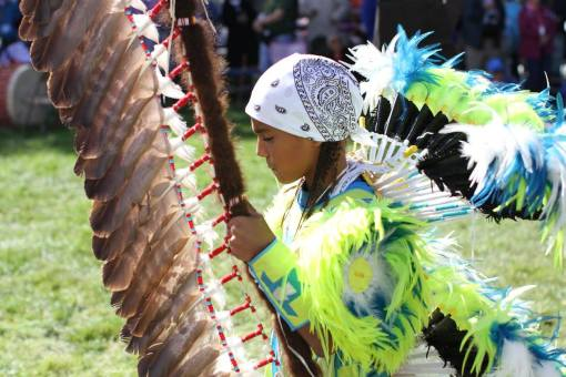 A Lakota (Sioux) student dances at the powwow on Chamberlain, South Dakota's St. Joseph's Indian School Campus.