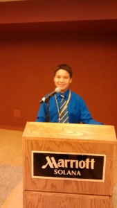 A Lakota (Sioux) student prepares for the donor luncheon.