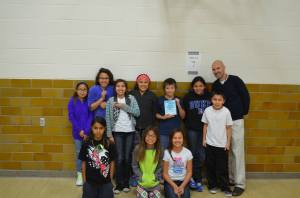 Lakota (Sioux) students with their teacher.